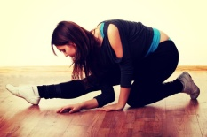 shutterstock_dm-young-woman-crouching-on-wood-floor